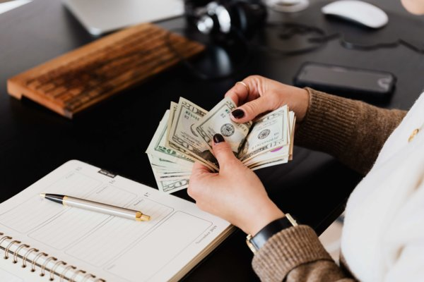 Woman Counting Cash During Audit