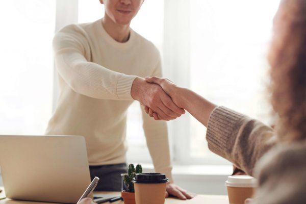 Two People shaking Hands After Interview
